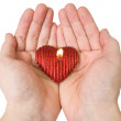 Heart-shape candle in a hands — Stock Photo