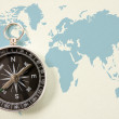 Royalty-Free Stock Photo: Black compass on blue world map