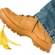 Man stepping on banana peel - Stock Photo