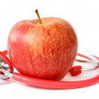 Red apple and stethoscope — Stockfoto
