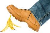 Man stepping on banana peel — Stock Photo