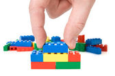 Hand and toy blocks — Stock Photo