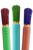 Three paintbrushes with color paint — Stock Photo