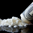 Cocaine and dollar on black background — Stock Photo