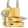 Three golden padlocks — Stock Photo