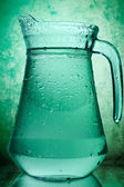 Water in a glass pitcher — Stock Photo