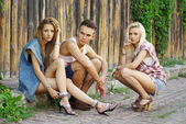 Fashion shot of a trendy group of young — Stock Photo