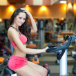 Girl with perfect body in fitness hall — Stock Photo #10630106