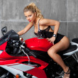 Sexy Blonde on sportbike - Stock Photo