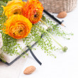 Yellow flowers, wicker baskets and a notebook — Stock Photo