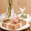 Table setting with pink flowers - Stock Photo