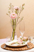 Table setting with pink flowers — Stock Photo