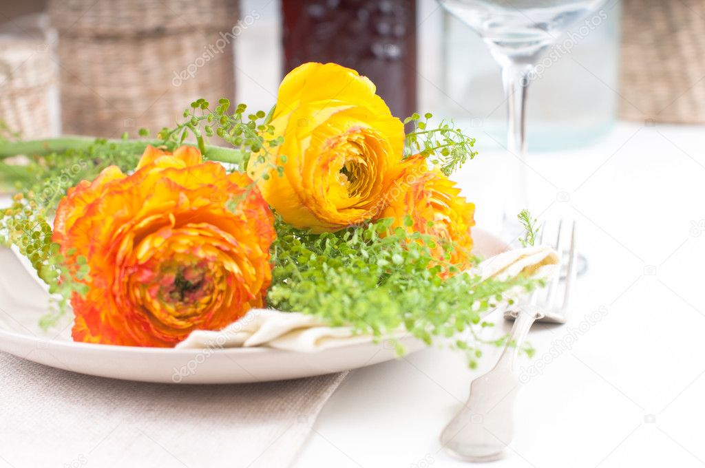 Festive dining table setting with yellow-orange flowers ranunkulus — Stock Photo #10199476