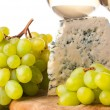 Blue cheese and grapes — Stock Photo