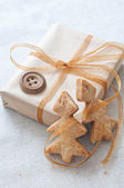 Christmas gift tied with ribbon — Stock Photo