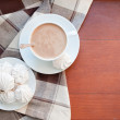Coffee and meringues with a brown cloth — Zdjęcie stockowe