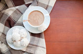 Coffee and meringues with a brown cloth — Stock Photo