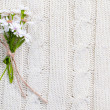 Wild flowers on a beige knitted texture — Stock Photo