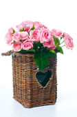 Bouquet of pink roses in a wicker basket — Stock Photo