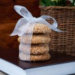 Cookies with a ribbon, books, and a bouquet — Stock Photo