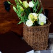 Yellow flowers in a wicker basket — Stock Photo