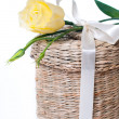 Wicker box with satin ribbon — Stock Photo