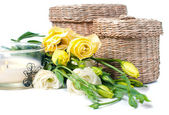 Wicker boxes, candles and flowers — Stock Photo