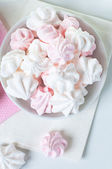White and pink meringue on a plate — Stock Photo