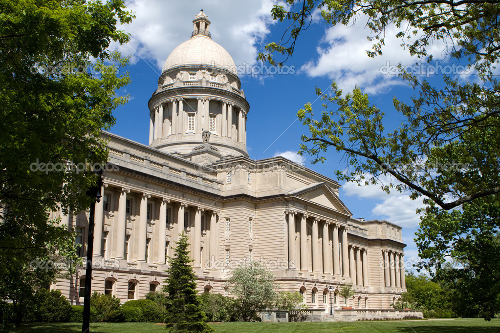 Kentucky statehouse capitol building in Frankfort, Kentucky, USA against a blue sky with clouds.  Stock Photo #10553001