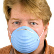 Man Wearing Dust Mask - Stock Photo