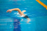 A swimmer swims — Stock Photo