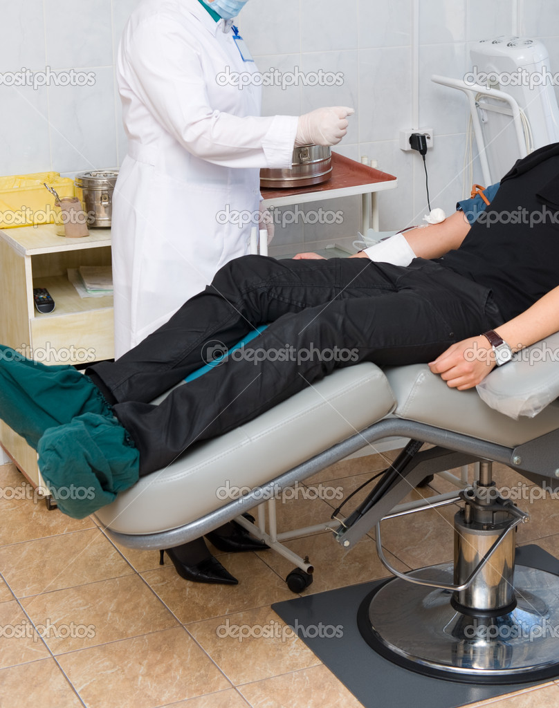 A male donor donates blood at a hemotransfusion station — Stock Photo #10121440