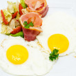 Bacon with eggs — Stock Photo