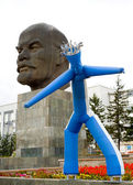 Inflatable man and Lenin's monument — Stock Photo