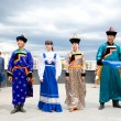 Actors in Russian and Buryat national costumes - Stock Photo