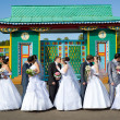 Stock Photo: Five kissing marrying couples