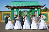 Five kissing marrying couples — Stock Photo