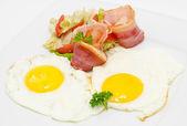 Bacon and eggs, closeup — Stock Photo