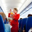 Stock Photo: Air hostess at work