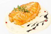 Salmon with cheese sauce — Stock Photo