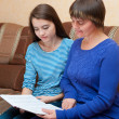 Mother and daughter read book — Stock Photo