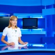 Television newscaster at TV studio — Stock Photo #8628837