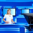 Stock Photo: Television newscaster at TV studio