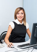 Young woman at computer — Foto Stock