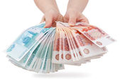 Hands offer Russian money — Stock Photo
