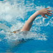 Foto Stock: Swimmer swims