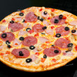 Stock Photo: Pizza with peperoni, mushrooms and ham