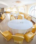 White and yellow restaurant interior — Stock Photo