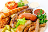 Sausages with sauces — Stock Photo