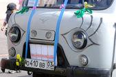 Minivan at callithump — Stock Photo